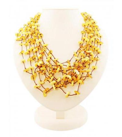 "Luxurious braided long necklace made of honey and lemon amber ""Gossamer"""