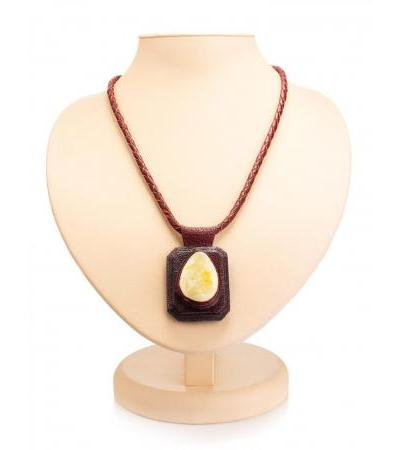 """Pendant made of burgundy leather and natural amber on a lace """"Amazon"""""""