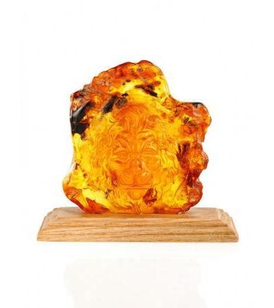"Decorative souvenir-carving on natural solid amber ""Lion"""