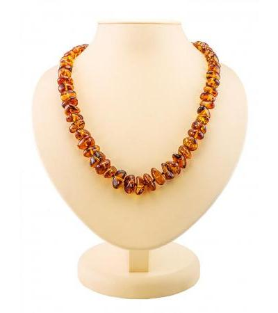 """Magnificent glossy beads made of natural amber """"Pebble cognac"""""""