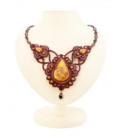 """Red openwork necklace with weaving elements and large inserts made of natural bright cognac amber """"India"""""""