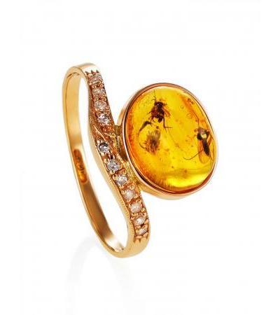 """Exquisite ring of gold and amber with inclusions, decorated with cubic zirkonia """"Clio"""""""
