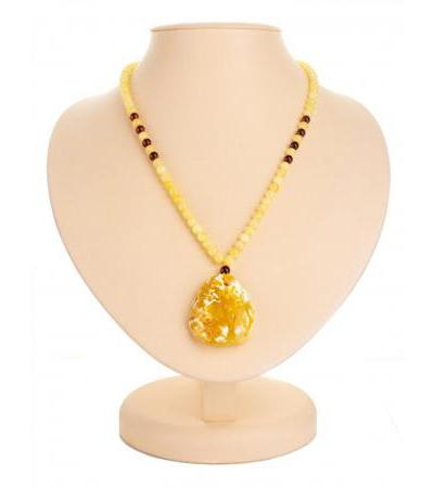 "Necklace with a pendant made of natural solid landscape amber ""Laura"""