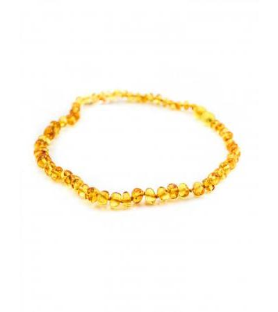 "Natural amber beads for children ""Pebble golden cognac"" for children"