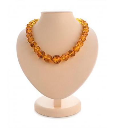 "Spectacular beads ""Crumpled ball"" made of natural Baltic amber of golden cognac color"