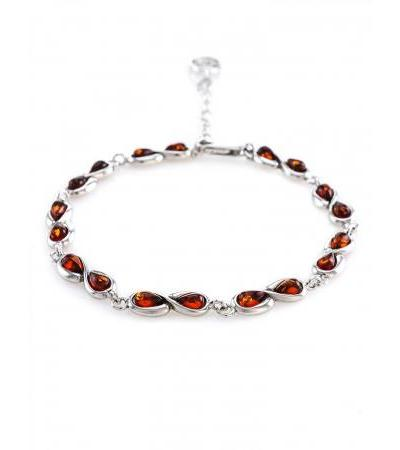 """Delicate bracelet """"Cupid"""" made of silver and natural amber cognac color"""