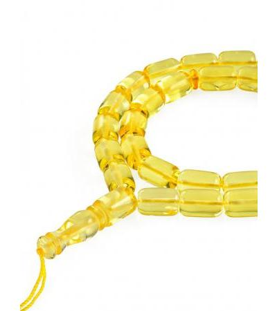 Beautiful rosary made of natural solid amber of bright lemon color