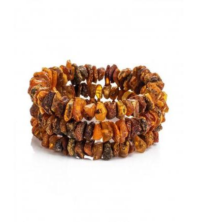 Dark bracelet on a string of amber with a healing effect