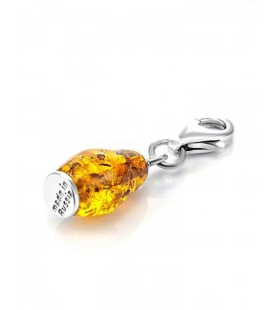 Unusual pendant made of silver and natural amber on the Matryoshka® carbine