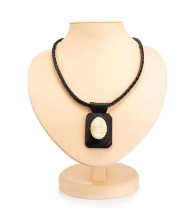 """Pendant on a cord made of leather and whole milk amber """"Amazon"""""""