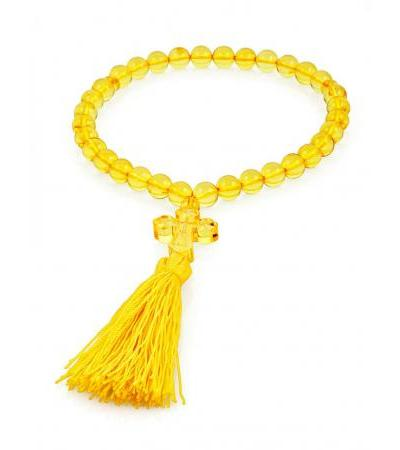 Orthodox rosary 33 beads made of natural lemon amber with a carved cross