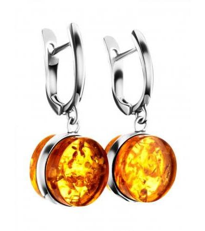 """Small original earrings """"Furor"""" made of silver and golden cognac amber"""