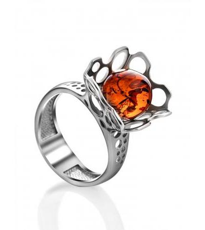 """Unusual ring made of silver with perforation and amber """"Geneva"""""""