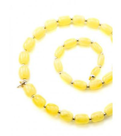 Beads from natural Baltic amber honey color with a curtain to create a necklace