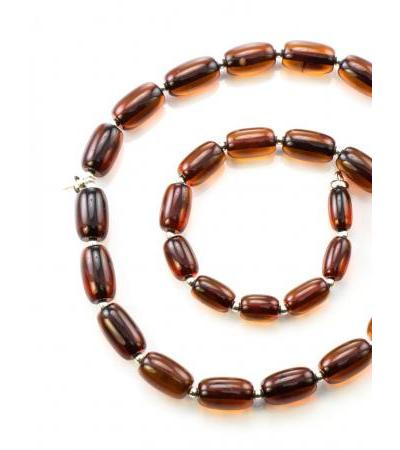 Amber beads-barrels of cognac color with a pin to secure the pendant