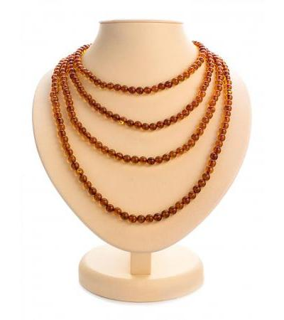 "Exquisite long beads from solid amber ""Cognac ball"""