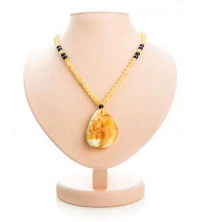 "Necklace with a large pendant made of natural landscape amber ""Laura"""