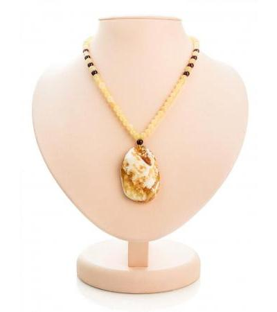 """Necklace with a pendant made of natural solid landscape amber """"Laura"""""""
