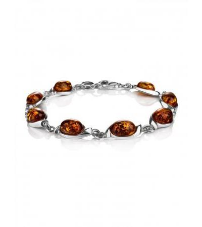 "Bracelet made of silver and natural solid amber of cognac color ""Suite"""