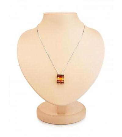 Stylish necklace made of silver and natural amber in warm shades