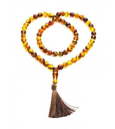 Muslim rosary on 66 beads-balls from variegated molded amber