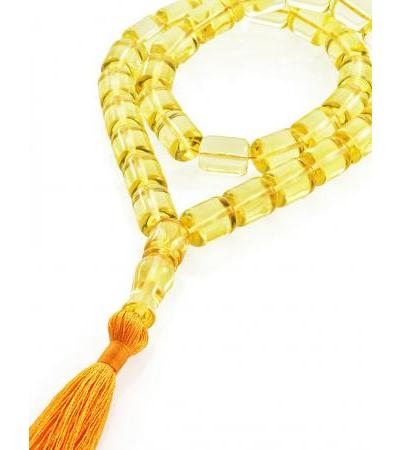 Glossy rosary made of natural lemon amber for 33 barrel beads