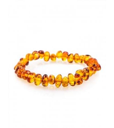 "Children's bracelet ""Pebbles"" made of natural Baltic amber of golden-cognac color"