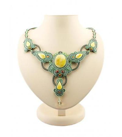 """Openwork green necklace with weaving elements and inserts from natural honey amber """"India"""""""