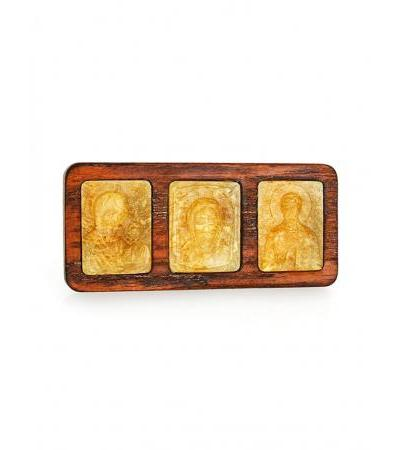 Set of three carved amber icons in a wooden car frame