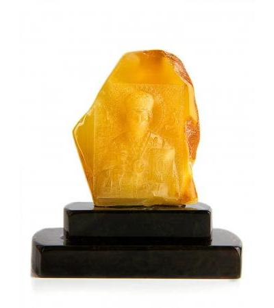 "Icon made of natural amber with carving ""Nicholas the Wonderworker"" on a stand"