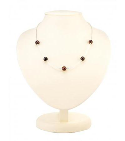 """Silver necklace """"Olympia"""" with amber balls of cherry-colored spacers"""
