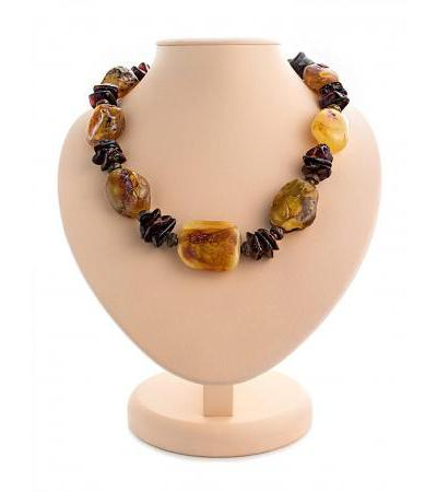 "Volumetric beads from whole pieces of natural amber with a natural texture and brass ""Indonesia"""