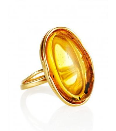 "Beautiful ring made of natural amber with a fly in a gilded frame ""Clio"""