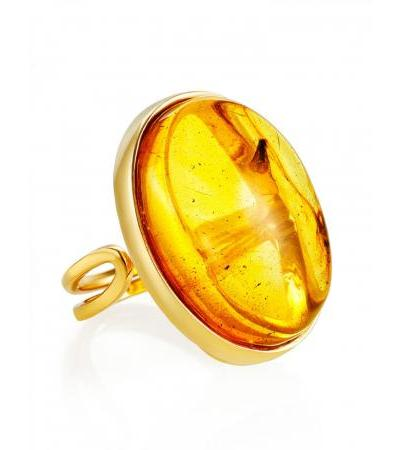 Large volumetric ring made of amber with the inclusion of the Clio fly