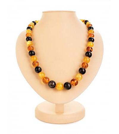 "Spectacular amber necklace ""Solaris"" from stones of different shades"