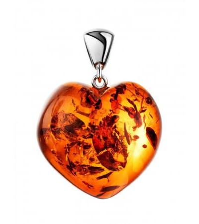 Luxurious pendant in the shape of a heart made of natural dark cognac amber