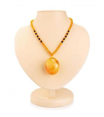 "Necklace ""Laura"" made of natural solid amber with a voluminous textured pendant"