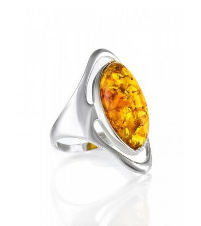 Large silver ring with an oval inset of sparkling Allegro lemon amber