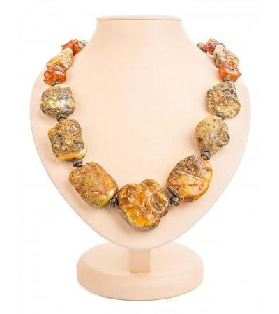 "Beads with a healing effect from large pieces of natural amber and brass ""Indonesia"""