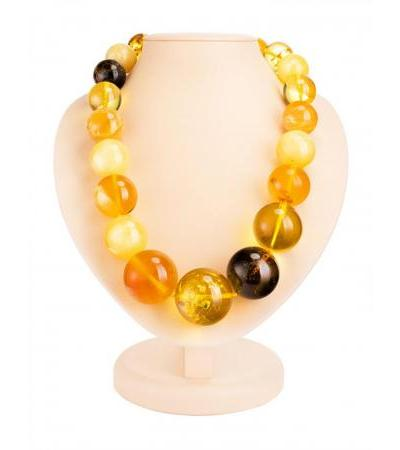 "Luxurious beads ""Solaris"" from natural solid amber of different shades"