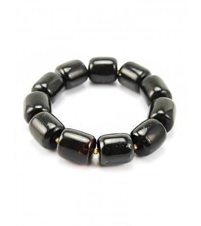 """Bracelet made of natural molded amber """"Barrels"""" of black color"""