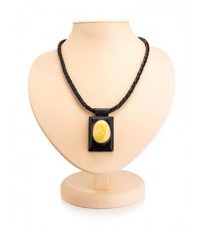 "Necklace with a pendant made of leather and natural amber ""Amazon"""