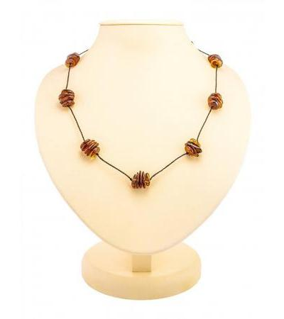 """Ethnic necklace made of natural amber cognac color """"Madagascar"""""""