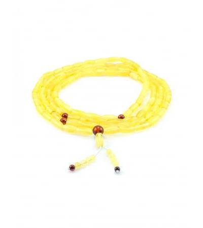 Long amber rosary of light honey color from cylinder beads