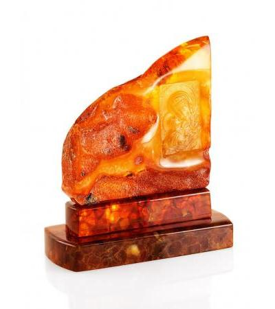 """A small carved icon made of natural solid amber with a natural crust """"Igorevskaya Mother of God"""""""
