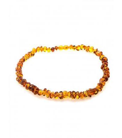 """Elegant children's beads from cognac amber """"Glossy pebbles"""" for children"""