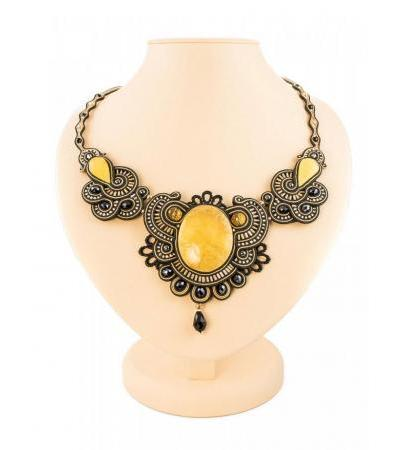 "Openwork braided necklace with inserts made of natural honey amber ""India"""