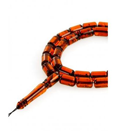 "Beads made of natural solid amber ""Transparent barrels"""