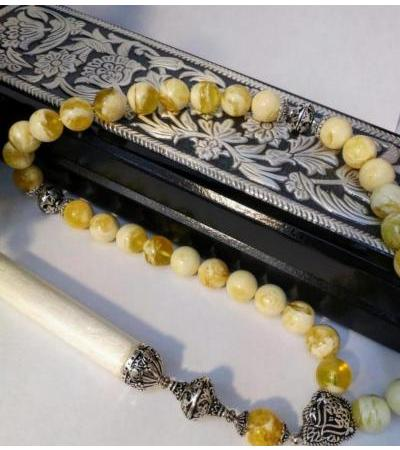 Rosary 33 beads with a divider and minaret, with silver inserts. Weight 50 g, diameter 12 mm